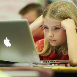 Kirra Eldridge studies her computer screen at East Midvale Elementary on Monday, Sept. 25, 2017.