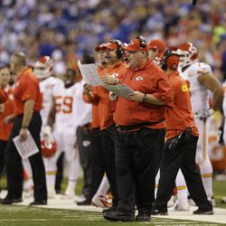 Kansas City Chiefs head coach Andy Reid watches during the first half of an NFL wild-card playoff football game against the Indianapolis Colts Saturday, Jan. 4, 2014, in Indianapolis. (AP Photo/Michael Conroy)