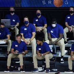 Utah Jazz's head coach Quin Snyder, second from left in the front row, watches with staff from the bench during the second half of an NBA basketball game against the Oklahoma City Thunder, Saturday, Aug. 1, 2020, in Lake Buena Vista, Fla.