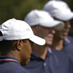 USA's Tiger Woods, Steve Stricker and Matt Kuchar look over the 11th green during a practice round at the Ryder Cup PGA golf tournament Wednesday, Sept. 26, 2012, at the Medinah Country Club in Medinah, Ill.