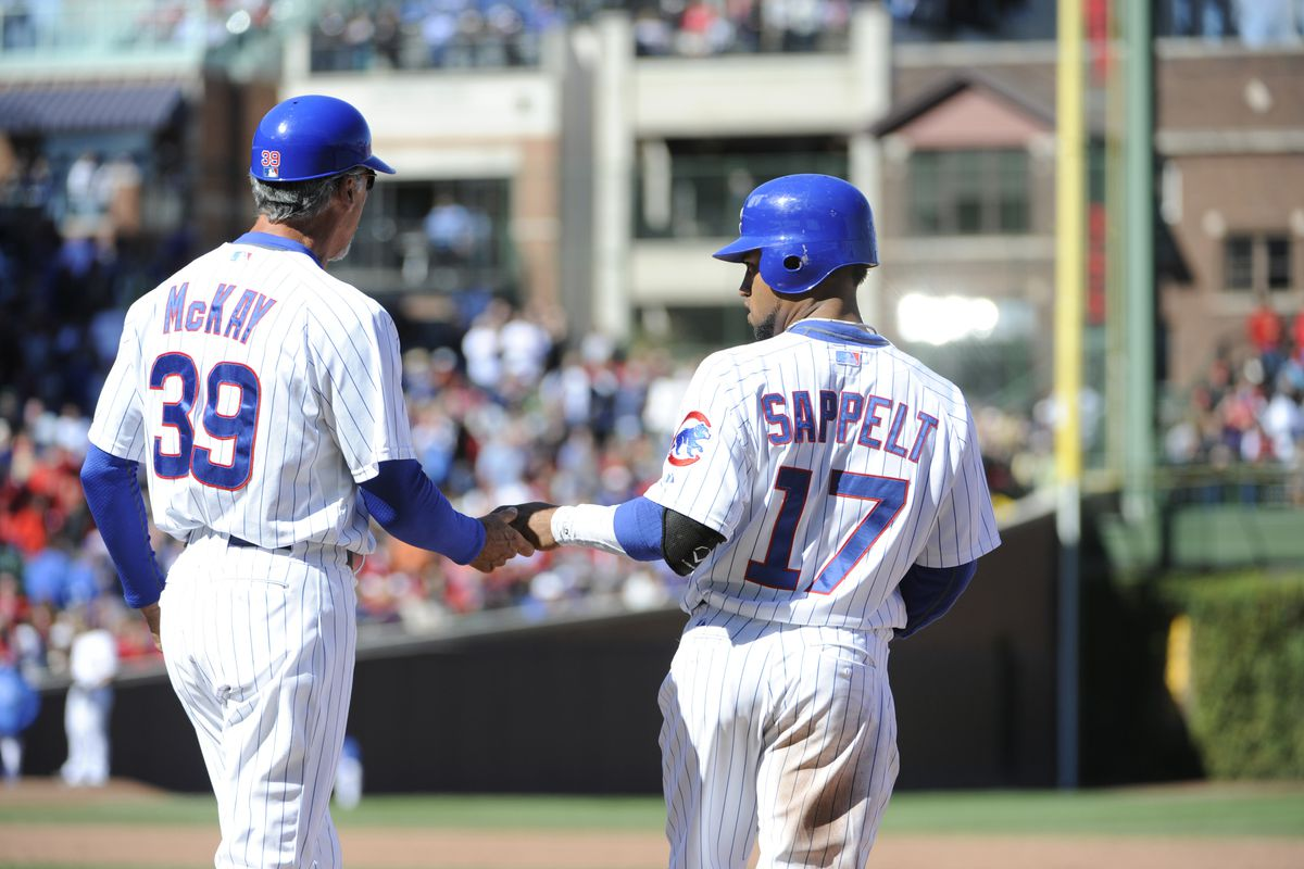 Dave Sappelt of the Chicago Cubs is greeted by first base coach Dave McKay after hitting an RBI single against the St. Louis Cardinals at Wrigley Field in Chicago, Illinois.  (Photo by David Banks/Getty Images)