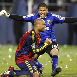 Real's Robbie Russell kneels after making the winning goal  as keeper Nick Rimando runs to congratulate him as Real Salt Lake defeats the Los Angeles Galaxy in a shootout to win the MLS Cup.