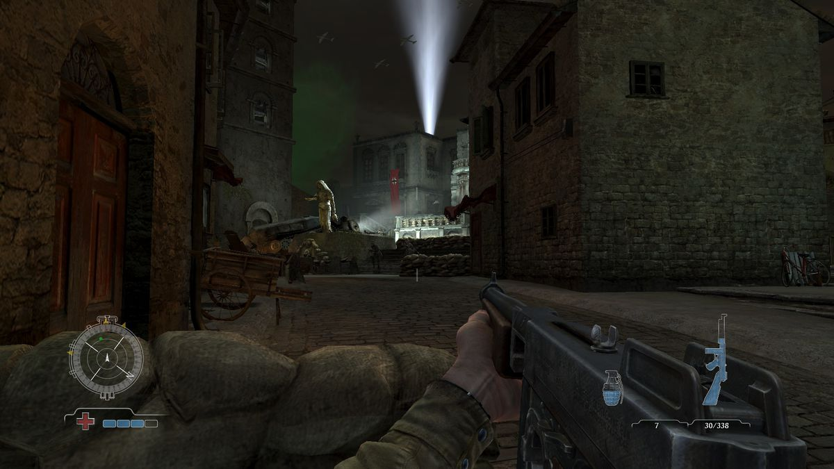 Medal of Honor: Airborne - standing behind a sandbag barrier, looking toward a town square