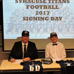 Syracuse football players Wyatt Bowles, left, and Ty Metcalfe sign National Letters of Intent at Syracuse High School on Wednesday, Dec. 20, 2017.