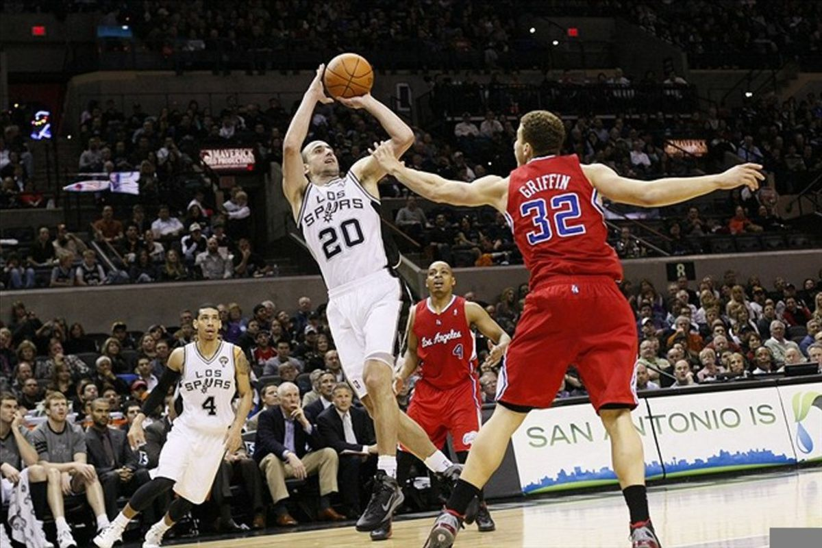 Mar 9, 2012; San Antonio, TX, USA; San Antonio Spurs guard Manu Ginobili (20) takes a shot over Los Angeles Clippers forward Blake Griffin (32) during the first half at the AT&T Center. Mandatory Credit: Soobum Im-US PRESSWIRE
