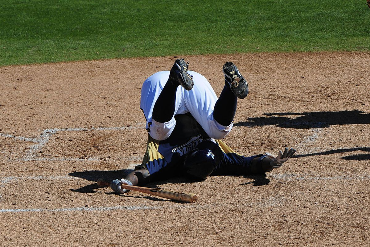 March 23, 2012; Phoenix, AZ, USA; Milwaukee Brewers center fielder Nyjer Morgan (2) falls after a pitch during the fifth inning against the Los Angeles Angels at Maryvale Baseball Park. Mandatory Credit: Kyle Terada-US PRESSWIRE