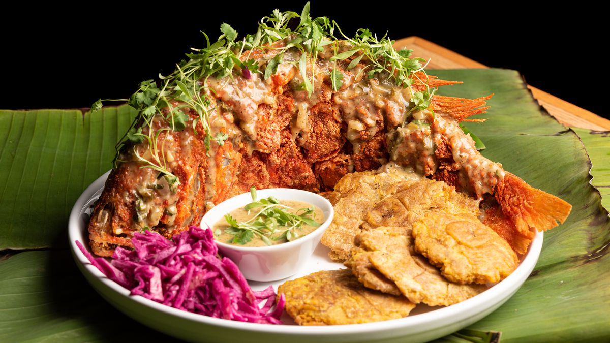 Chiofrito, or whole fried snapper at Rumba Kitchen in Little Tokyo with tostones and other sides.