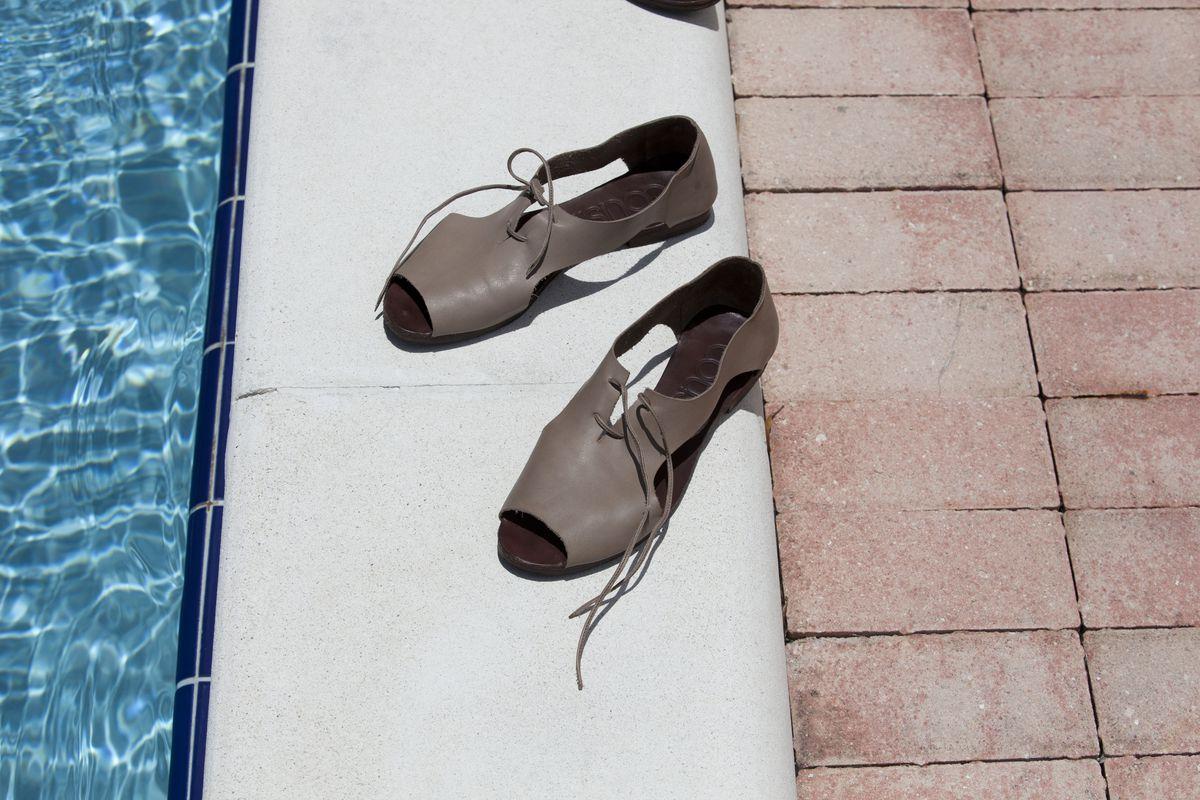 A cutaway Oxford sandal, sitting by the pool.