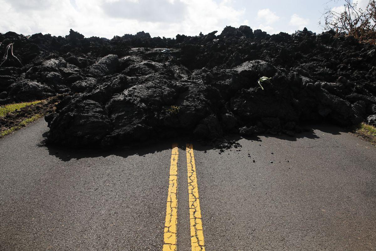 A lava-covered road in the Leilani Estates subdivision near Pahoa, Hawaii, on Friday.   Jae C. Hong/Associated Press