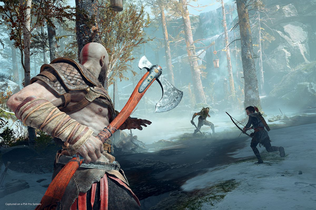 God of War - Kratos and Atreus prepare to fight an enemy in the woods