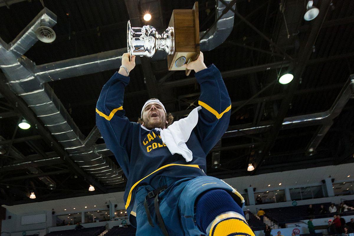 Kyle Gibbons celebrates with the 2013 Atlantic Hockey Association Tournament championship trophy.