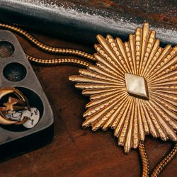 """The RA Starburst Bolo Necklace, <a href=""""http://www.gilliansteinhardtjewelry.com/collections/necklaces/products/ra-starburst-bolo-necklace"""">$335</a>"""
