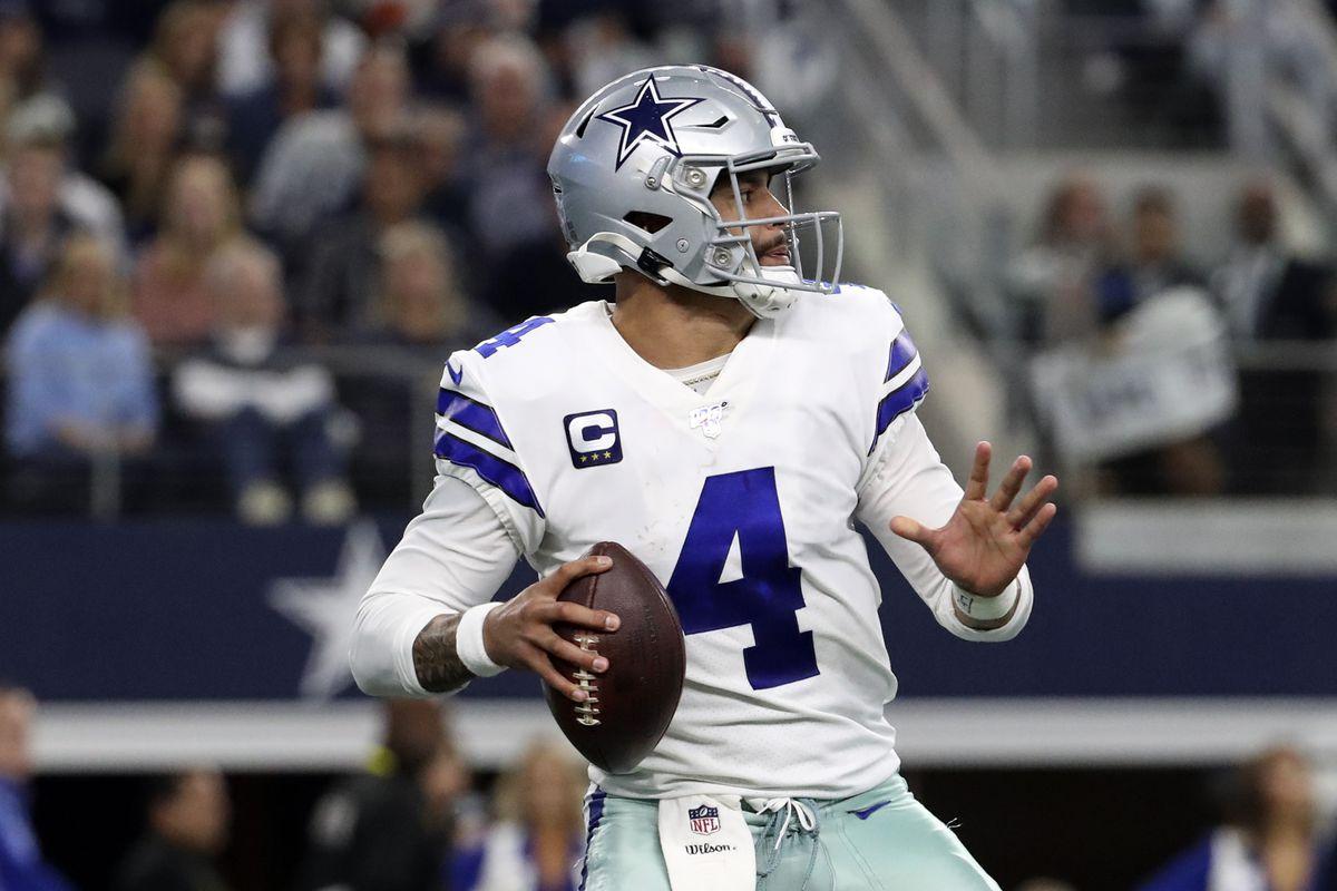 Dallas Cowboys quarterback Dak Prescott throws during the second quarter against the Washington Redskins at AT&T Stadium.