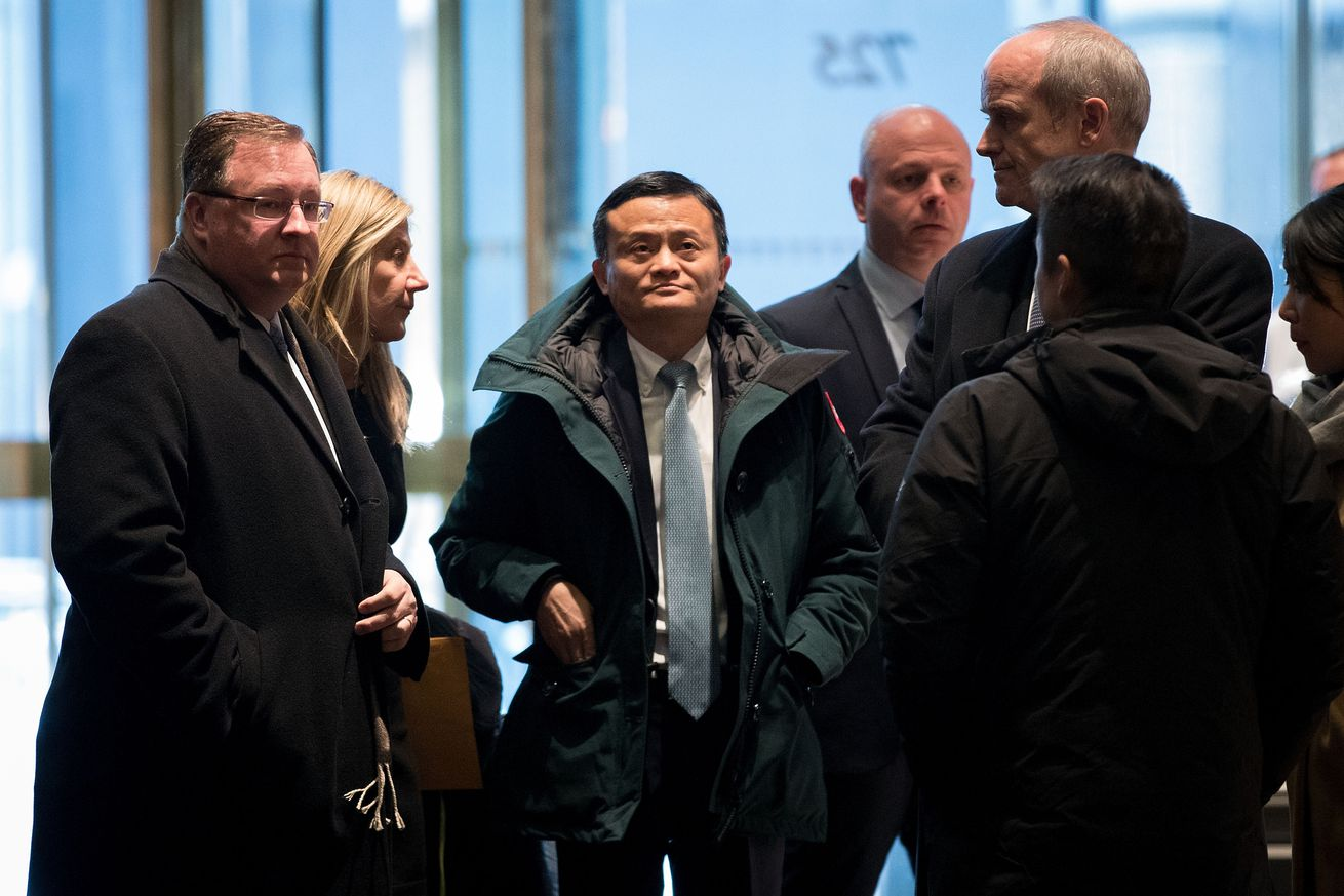 Jack Ma (center) arriving at Trump Tower last year, where he made the promise to bring one million jobs to the US.