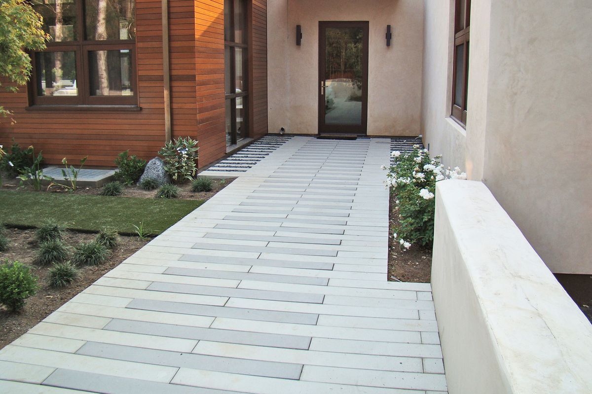 Concrete paver leading up to a doorway.