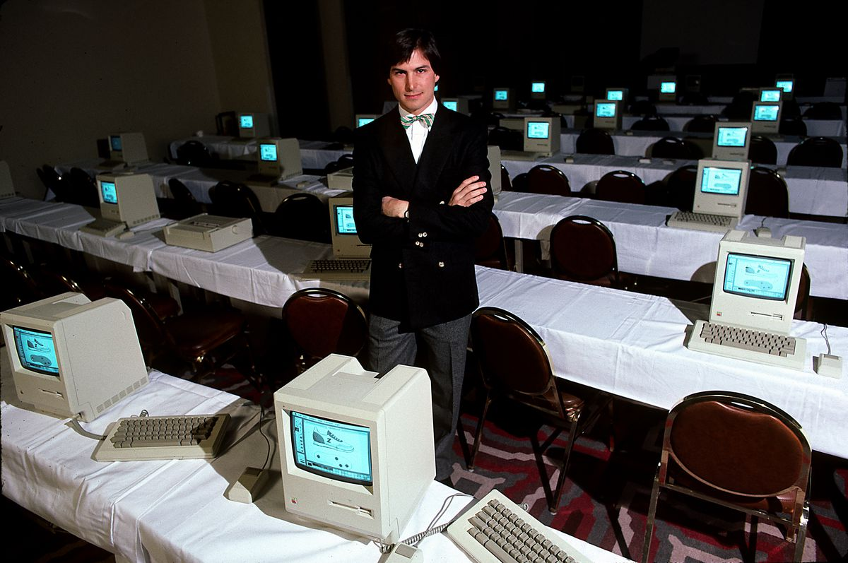 Steve Jobs with room full of computers, 1984.