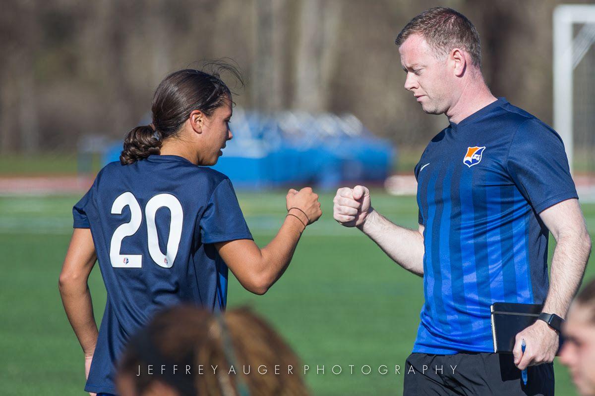 Sky Blue FC's Sam Kerr and head coach Christy Holly fist bump