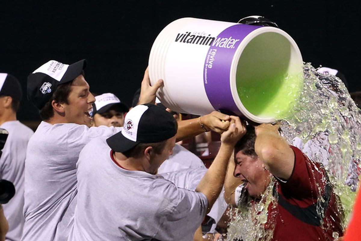 <em>Coach Ray Tanner gets a well-deserved bath after he and his team secure South Carolina's first ever NATIONAL CHAMPIONSHIP in baseball! </em>(Photo by Christian Petersen/Getty Images)