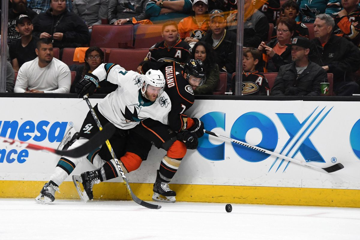 Apr 14, 2018; Anaheim, CA, USA; San Jose Sharks defenseman Paul Martin (left) and Anaheim Ducks left wing Andrew Cogliano battle for the puck during the second period in game two of the first round of the 2018 Stanley Cup Playoffs at Honda Center. The Sharks defeated the Ducks 3-2 to take a 2-0 series lead.
