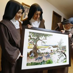 Sister Therese, Mother Maureen and Sister Margaret Mary look over an embroidery piece crafted by the nuns that took a year to complete and will be auctioned the Carmelite Fair in Holladay Tuesday, Sept. 16, 2014.