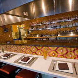 Guests can dine at the casual counter looking into the kitchen