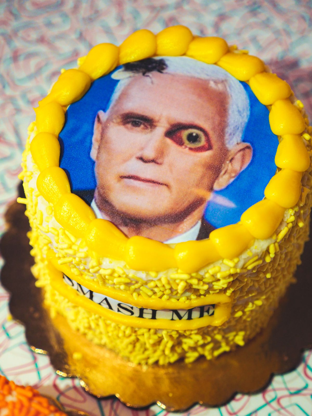 A cake decorated with Mike Pence's photo.