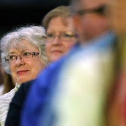 Corliss Clayton and others listen during the general session of RootsTech at the Salt Palace in Salt Lake City on Friday, Feb. 10, 2017.
