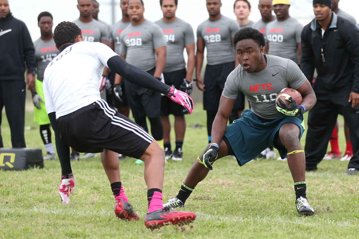 D.J. Brown breaks a defenders ankles during some drills at a camp this spring.
