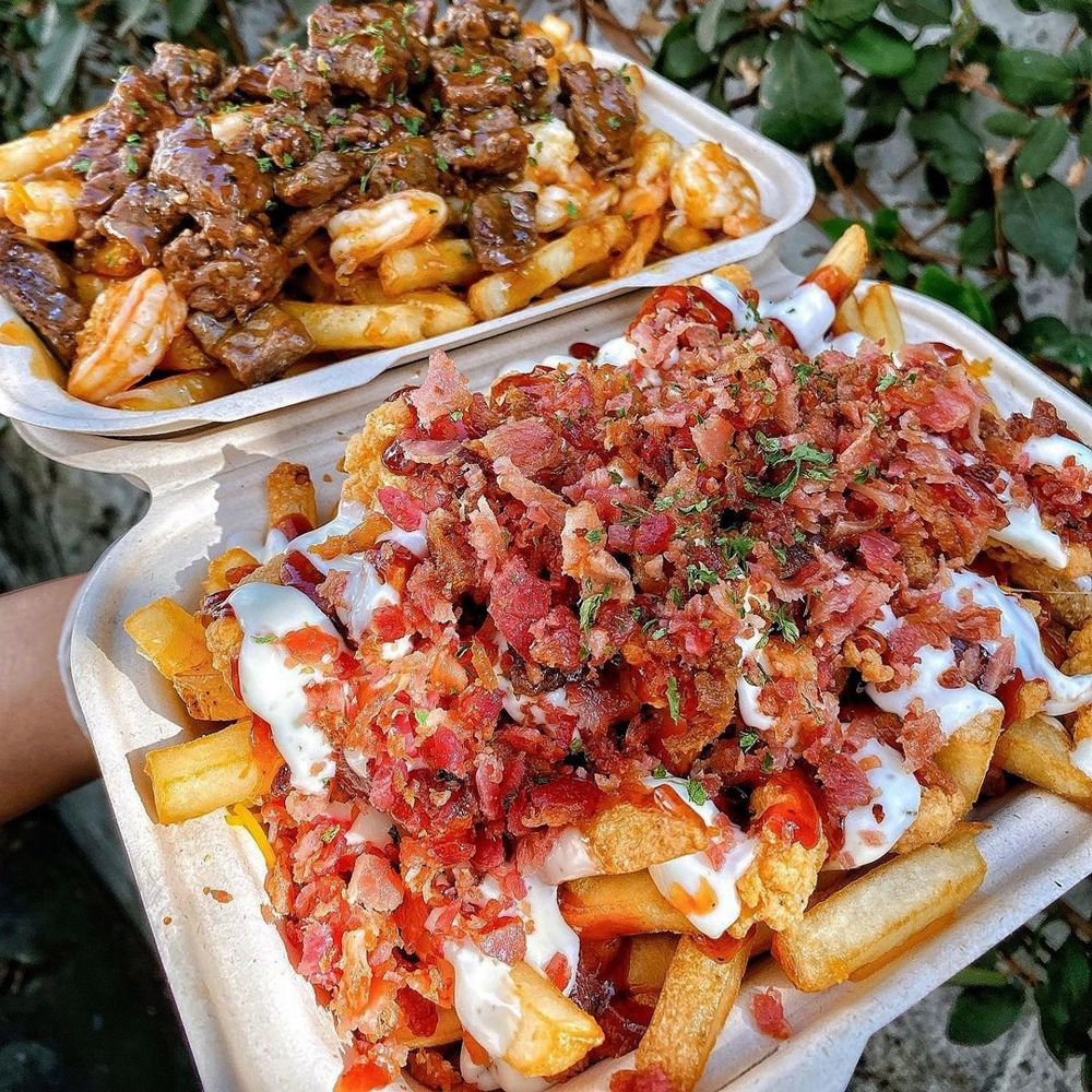 Servings of bacon ranch chicken, plus steak and shrimp fries at L.A.'s Mr Fries Man.