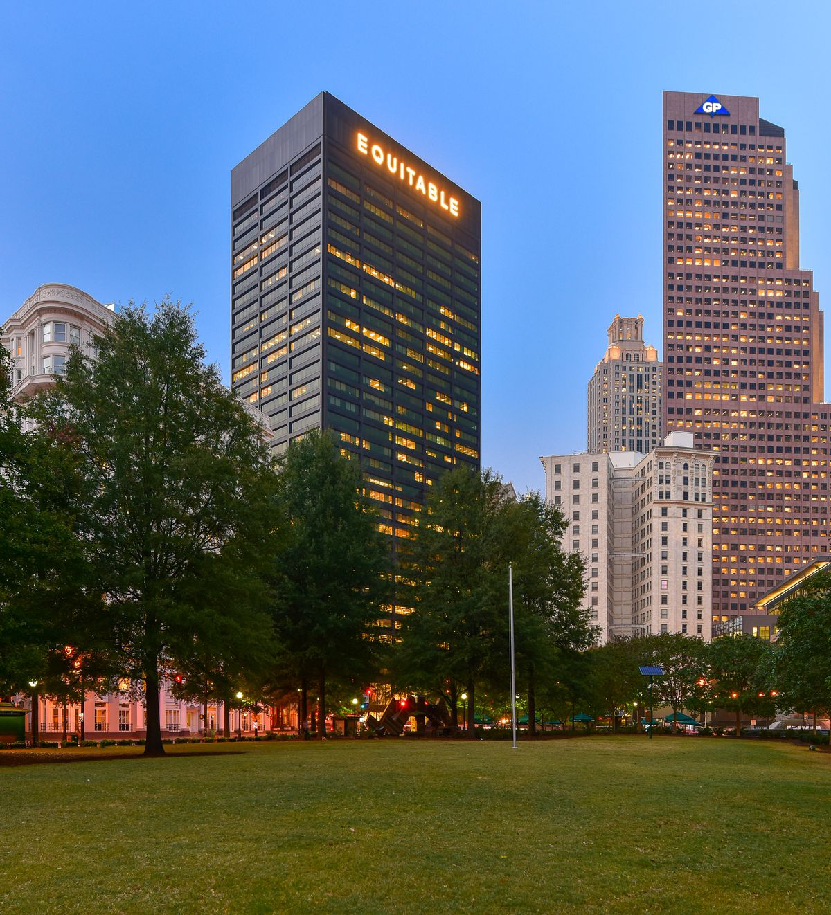 A photo of Woodruff Park and the Equitable Building in downtown Atlanta.