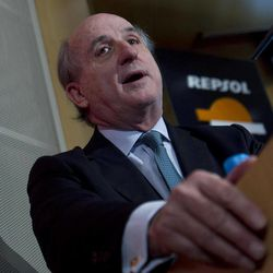 """Repsol president Antonio Brufau speaks during a news conference in Madrid Tuesday April 17, 2012. Shares of Spanish energy firm Repsol are plunging after Argentina announced a plan to nationalize the company's majority stake in Argentine oil and exploration unit YPF and Repsol's president is accusing Argentina of mounting a concerted effort to drive down the value of the South American division to buy it at a """"bargain"""" price. Brufau says YPF is worth $18.3 billion, and he valued Repsol's stake at $10.5 billion."""