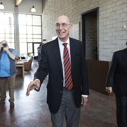 President Henry B. Eyring, first counselor in the First Presidency of the Church of Jesus Christ of Latter-day Saints, shakes hands after dedicating the Thomas S. Monson Lodge at the Hinckley Scout Ranch in the Uinta Mountains on Wednesday, Oct. 5, 2016.