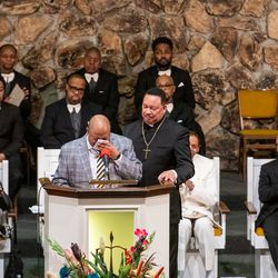 Pastor Mack C. Mason (left) breaks down while speaking about the life and legacy of Pastor Maceo L. Woods, during the wake and funeral for Woods at Christian Tabernacle Church, Saturday, Jan. 18, 2020, in Chicago.