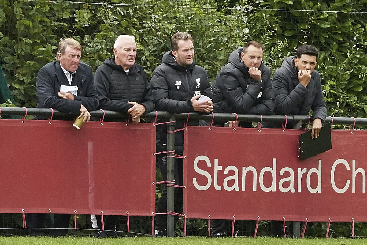Former Liverpool players Kenny Dalglish and Steve Heighway with Academy Director Alex Inglethorpe, Phil Roscoe and Nick Clarke watch the action during the PL2 game at The Kirkby Academy on August 10, 2019. Phil Roscoe is the club's Academy player care manager.