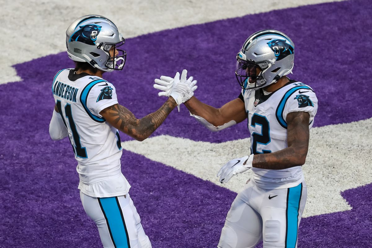 Carolina Panthers wide receiver Robby Anderson celebrates with wide receiver D.J. Moore after scoring a touchdown against the Minnesota Vikings during the second quarter at U.S. Bank Stadium.