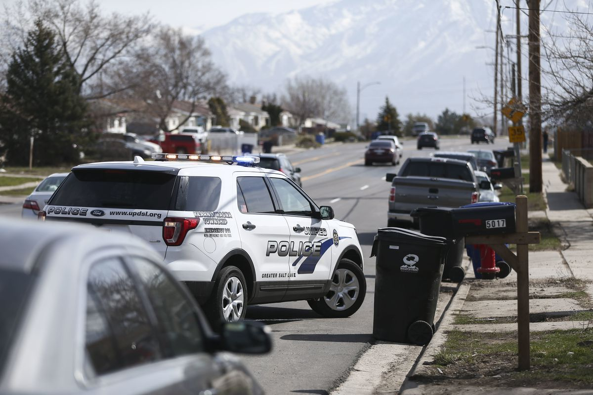 A police car is pictured at the site of an accidental shooting death in Kearns on Monday, March 18, 2019. A 16-year-old boy playing with a shotgun accidentally shot and killed himself inside his home.