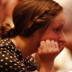 A member of the audience listens during the 182nd Annual General Conference for The Church of Jesus Christ of Latter-day Saints at the LDS Conference Center in Salt Lake City on Saturday, March 31, 2012.