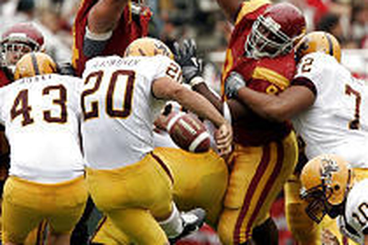 Southern Cal defenders block a field-goal attempt by Arizona State kicker Jesse Ainsworth in the first quarter of No. 1 USC's victory Saturday in Los Angeles.