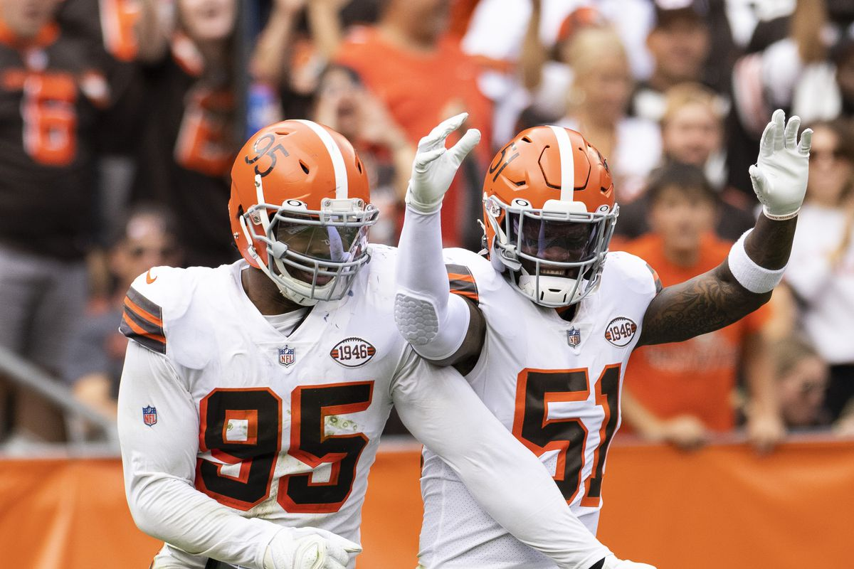 Browns defensive end Myles Garrett (95) celebrates his sack with outside linebacker Mack Wilson (51) against the Chicago Bears during the fourth quarter at FirstEnergy Stadium.