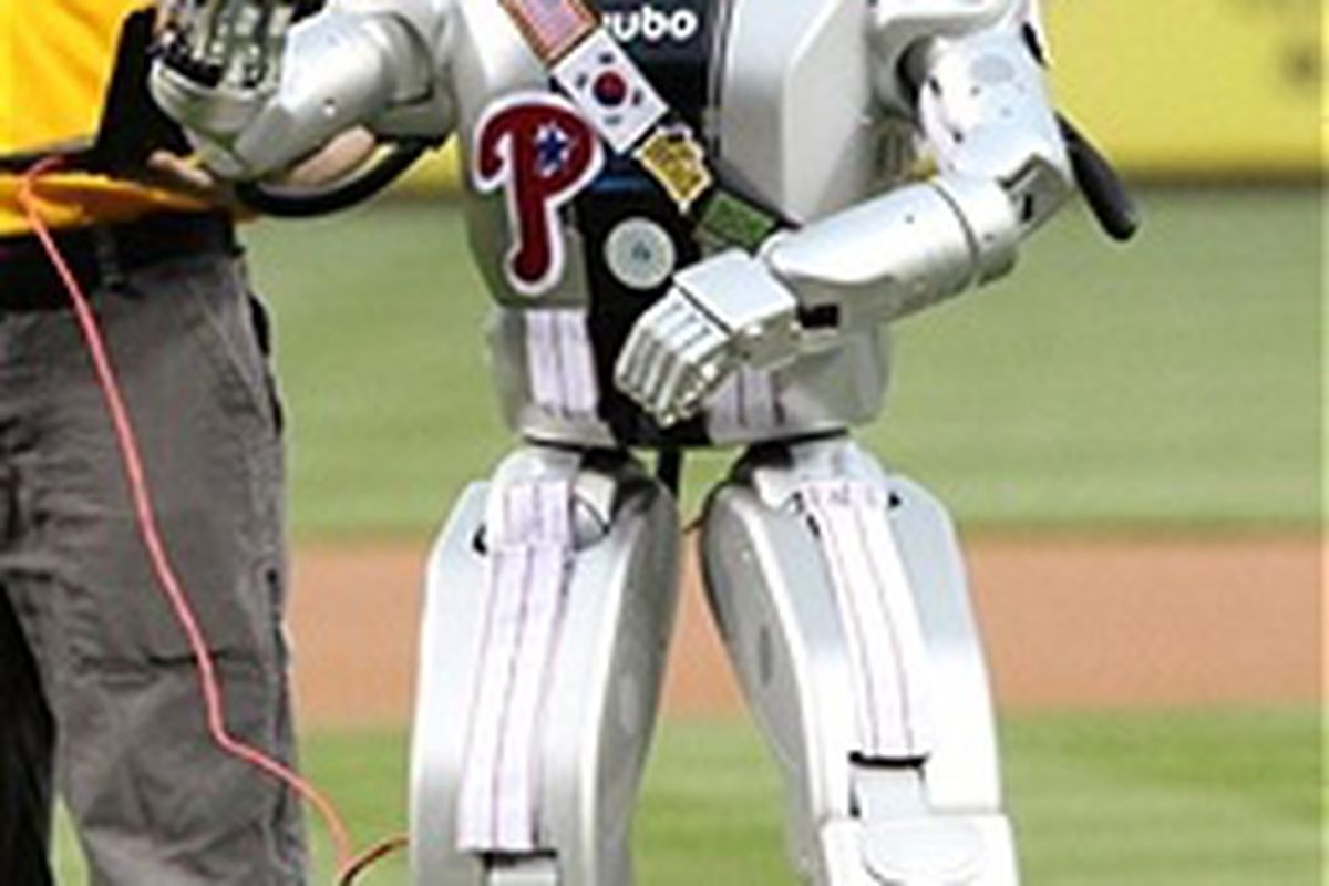 HUBO, the humanoid robot, throws out the first pitch before a game between the Philadelphia Phillies and the Chicago Cubs at Citizens Bank Park on April 28, 2012 in Philadelphia, Pennsylvania. (Photo by Hunter Martin/Getty Images)