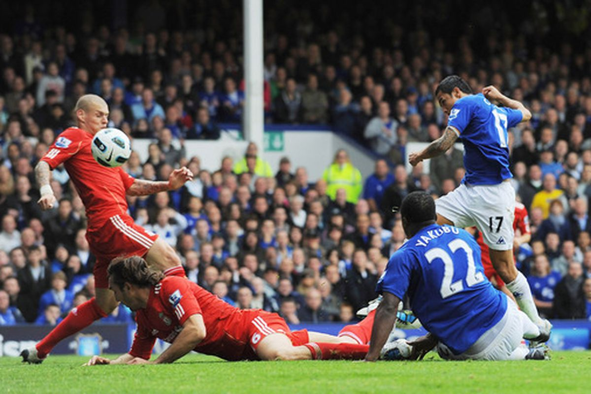 LIVERPOOL ENGLAND - OCTOBER 17:  Tim Cahill (R) of Everton scores the opening goal during the Barclays Premier League match between Everton and Liverpool at Goodison Park on October 17 2010 in Liverpool England.  (Photo by Michael Regan/Getty Images)