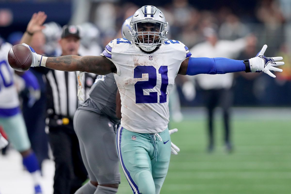 Ezekiel Elliott of the Dallas Cowboys reacts after completing a pass against Jarrad Davis of the Detroit Lions in the fourth quarter at AT&T Stadium on September 30, 2018 in Arlington, Texas.