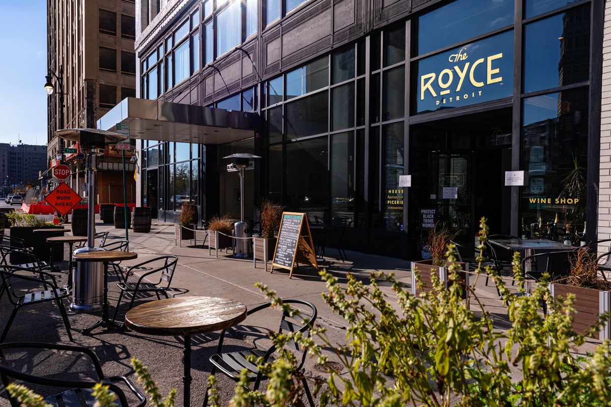 A patio with gas heaters outside the Royce is empty in downtown Detroit on a sunny fall day.
