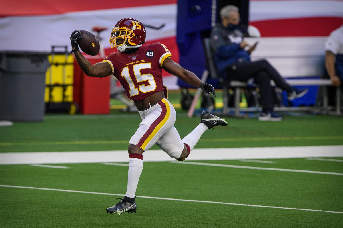 Washington Football Team wide receiver Steven Sims (15) warms up before the game against the Dallas Cowboys at AT&T Stadium.