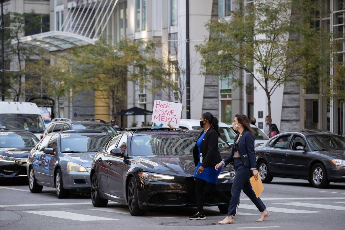 Community activists and Mercy Hospital and Medical Center employees drive by the James R. Thompson Center in downtown to protest the closure of Mercy Hospital and Medical Center.