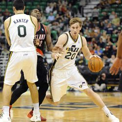 Utah Jazz small forward Gordon Hayward (20) follows the screen of teammate Utah Jazz center Enes Kanter (0) on Portland Trail Blazers shooting guard Wesley Matthews (2) in the second half of a game at the Energy Solutions Arena on Wednesday, October 16, 2013.
