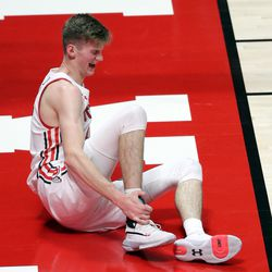 Utah Utes center Branden Carlson (35) grabs his angle in pain after getting injured during a men's basketball game against the Colorado Buffaloes at the Huntsman Center in Salt Lake City on Monday, Jan. 11, 2021. Utah lost 58-65.