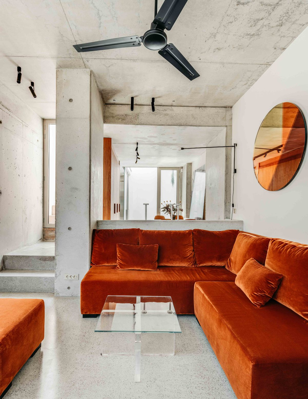 View of living room with burnt orange couch