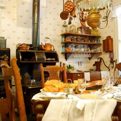 A meal looks like it is about to be served in the kitchen of the gingerbread Gibbons home at Lagoon?s Pioneer Village. Authentic furniture, stoves and other accoutrements fill the abode.