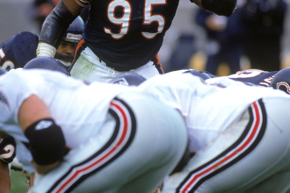 Defensive end Richard Dent of the Chicago Bears points as he looks over the Atlanta Falcons offense during a game at Soldier Field. (Photo by Jonathan Daniel/Getty Images)